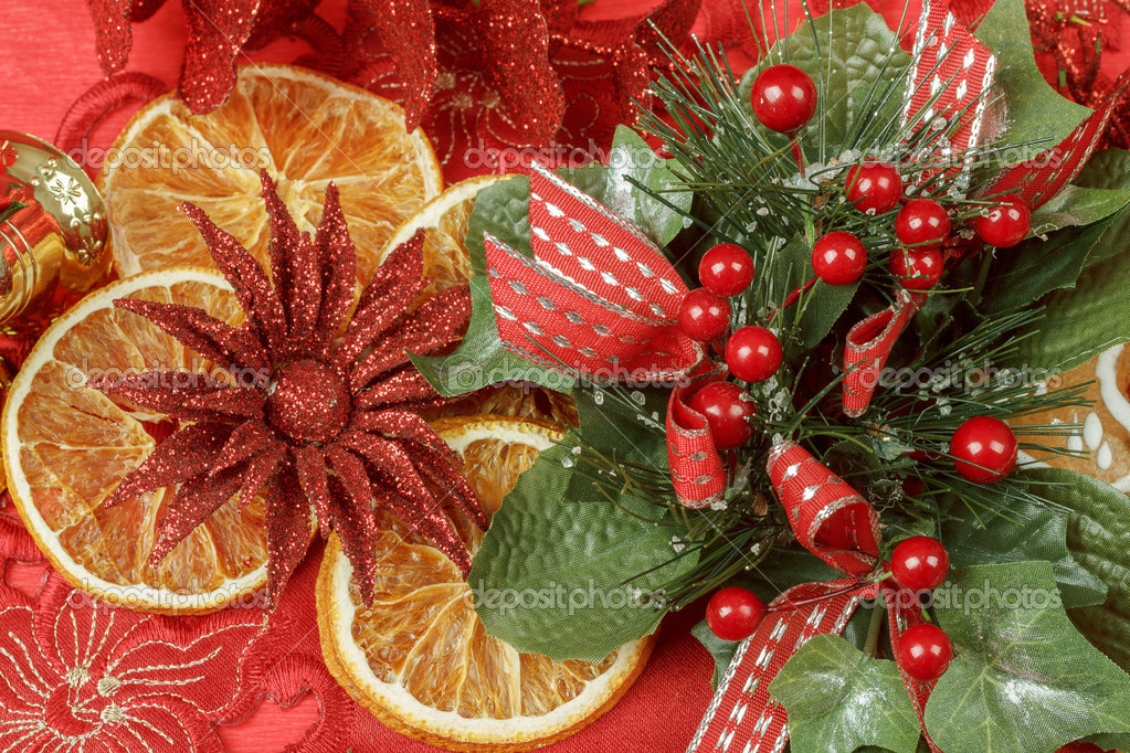 Christmas background with needles. orange slices and gingerbreads on red — Stock Photo #17876719