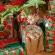 Stock Photo: Detail of gifts under decorated christmas tree