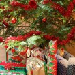 Detail of gifts under decorated christmas tree — Stock Photo #17979889
