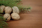 Walnuts on wooden background — Stock Photo