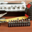 Stock Photo: Screwdriver toolbox with set of bits, pliers and measuring tape