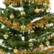Decorated christmas tree with yellow and green balls — Stock Photo #18405485