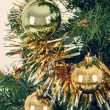 Decorated christmas tree with yellow and green balls — Stock Photo