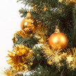 Yellow decorated christmas tree — Stock Photo