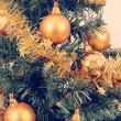 Yellow decorated christmas tree — Stock Photo #18507933