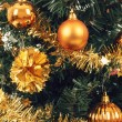 Stock Photo: Yellow decorated christmas tree