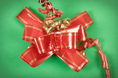 Red ribbon on gift — Stock Photo