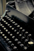 Old typewriter keys close up selective focus with retro colors — Stock Photo