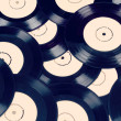 Black vinyl records vintage toned — Stock Photo #19315399