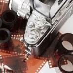 Analog vintage SLR camera and color negative films — Stock Photo #22486579