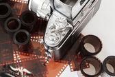 Analog vintage SLR camera and color negative films — Stock Photo