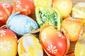 Bright color easter eggs with bows — Stock Photo