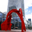 PARIS - May 8: Red arch in business district of Defense to the w — Stock Photo