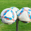Stock Photo: Three football bals on holders