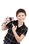 Small boy showing analog camera — Stock Photo