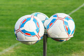 Trzy piłki nożnej bals posiadaczom — Zdjęcie stockowe