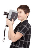 Young boy with old vintage analog 8mm camera — Stock Photo