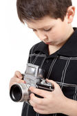 Young boy with old vintage analog SLR camera — Stock Photo