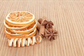 Star Anise, cinnamon and dried orange wooden background — Stock Photo