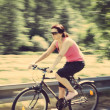 Stock Photo: Pretty womriding bicycle