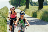 Mother with two sons on bicycle trip — Stock Photo