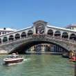 Stock Photo: ITALY, VENICE - JULY 2012 - lot of traffic on Grand Canal under Ponte di Rialto on July 16, 2012 in Venice. More th20 m