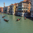 Stock Photo: ITALY, VENICE - JULY 2012 - lot of traffic on Grand Canal on July 16, 2012 in Venice. More th20 million tourists come to Venice annually.