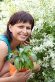 Happy smiling middle age woman gardening — Stock Photo
