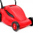 New red lawnmower on white background — Stock Photo #32170653