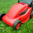 Stock Photo: New lawnmower on green grass