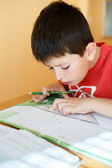 Boy doing school homework — Stok fotoğraf
