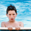 Boy in the swimming pool — Foto de Stock