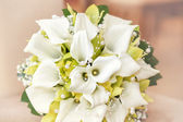 Wedding bouquet with pearls, orchid and calla — Stock Photo