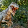 Stock Photo: Model of big tyranosaurus rex jungle