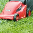 New lawnmower on green grass — 图库照片