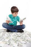 Boy sitting on money, money concept — Stock Photo