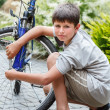Teenager repairing his bike, changing broken tyre — Stock Photo #36692853