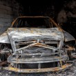 Close up photo of a burned out car — Stock Photo #36885039