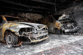 Close up photo of a burned out cars — Foto Stock