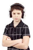 Portrait of a young boy listening to music on head — Stock Photo