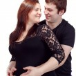 Loving happy couple, smiling pregnant woman with her husband — Stock Photo #37809501