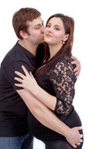 Loving happy couple, husband kissing pregnant woman — Stock fotografie