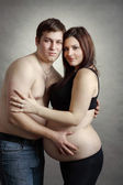 Loving happy couple, pregnant woman with her husband — Stock Photo