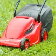 New lawnmower on green grass — Stock Photo #40499005