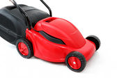 New red lawnmower on white background — Stock Photo
