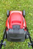 New lawnmower on green grass — Stock Photo