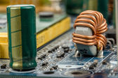 Computer motherboard, detail of capacitor — Stock Photo