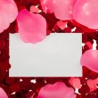 Small red confetti and big hearts on white background — Stock Photo #41904613