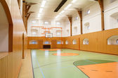 Empty interior of public gym with basketball court — Stock Photo