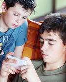 Teenager boys playing on smartphone, outdoor — Stock Photo